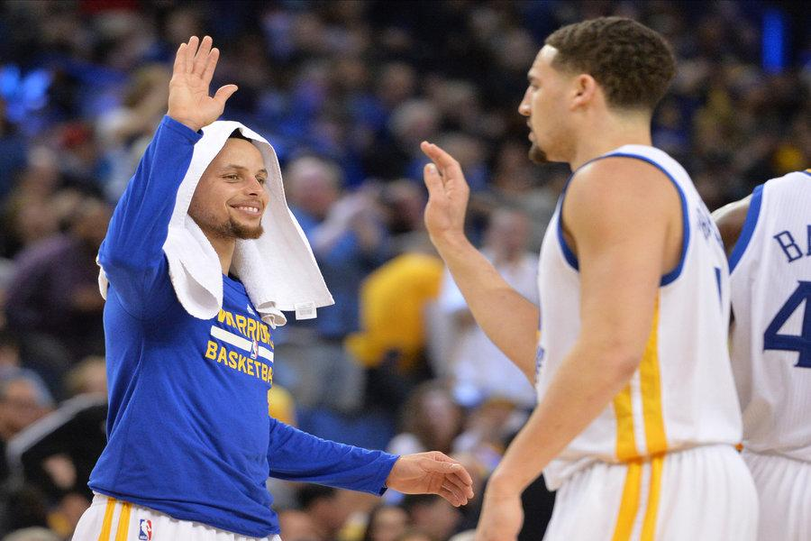 The Golden State Warriors' Stephen Curry, left, congratulates Klay Thompson during a timeout in the first period against the Portland Trail Blazers at Oracle Arena in Oakland, Calif., on Friday, March 11, 2016. (Doug Duran/Bay Area News Group/TNS)