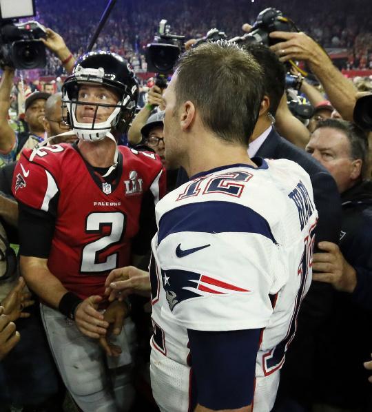 Matt Ryan and Tom Brady shake hands after the game.
