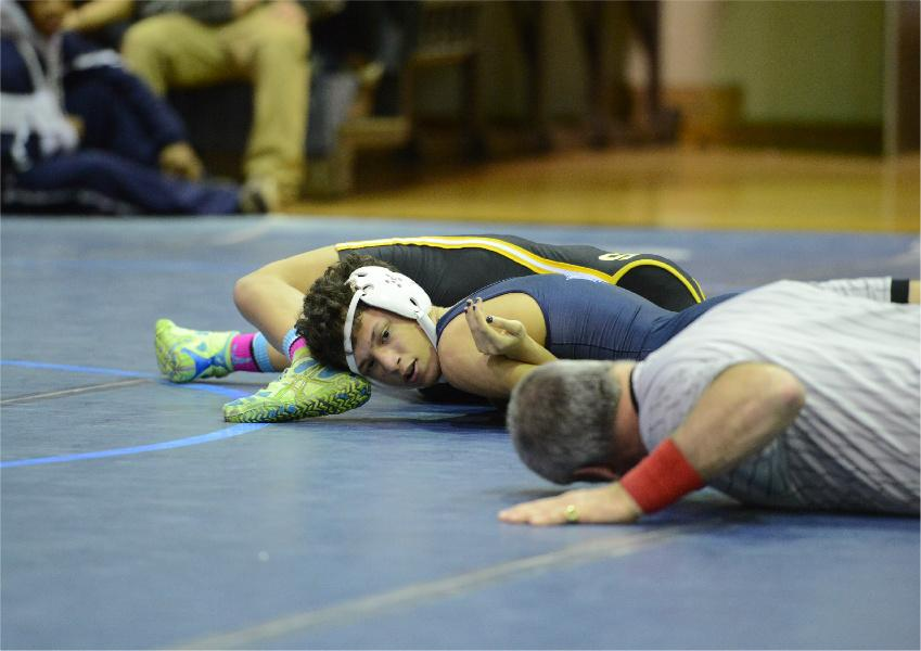 Chris Balmoris pins down his opponent against the mat.