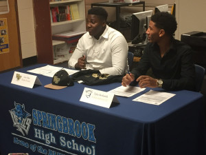 Two athletes commit to play football on full scholarships