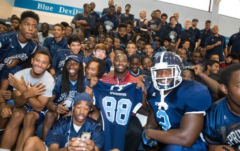 Garcon donates new football uniforms