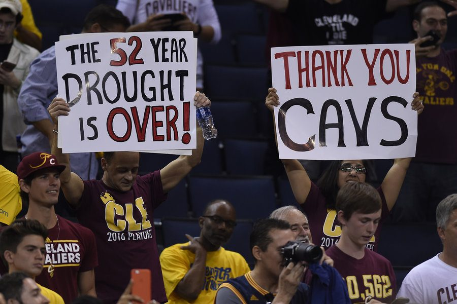 Cavalier fans hold signs after the Cleveland Cavaliers defeated the Golden State Warriors in Game 7 of the NBA Finals on Sunday, June 19, 2016, at Oracle Arena in Oakland, Calif. (Jose Carlos Fajardo/Bay Area News Group/TNS)