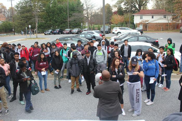 Students+gather+in+the+parking+lot+with+and+hear+a+few+remarks+from+the+principal+Dr.+Art+Williams.
