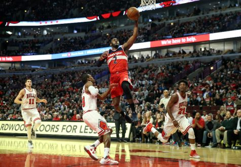 John Wall drives past PG Rajon Rondo in a 107-97 win vs. Chicago Bulls(Nuccio DiNuzzo/Chicago Tribune/TNS)