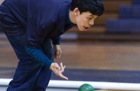 Simone Lowenstein uses laser focus to roll his  bocce ball.