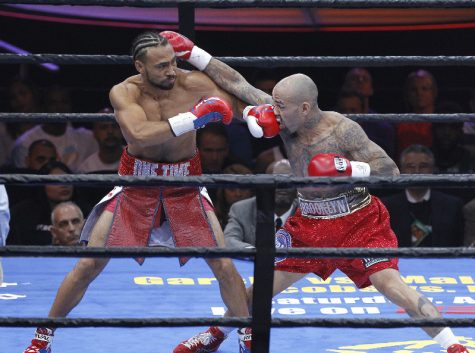"Keith ""One Time"" Thurman, left, beating Luis Collazo in the third round of their WBA Welterweight fight."