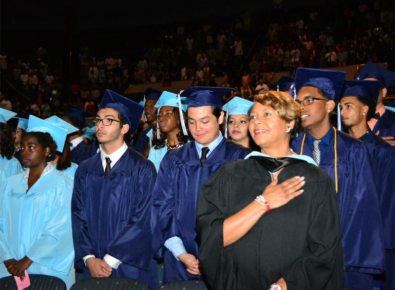 Counselor+Ms.+Brown+Miles+stands+with+the+graduating+class+of+2015.