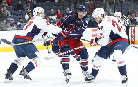 The Columbus Blue Jackets' Boone Jenner (38) is sandwiched by the Washington Capitals' Karl Alzner (27) and Brooks Laich (21) in the third period at Nationwide Arena.