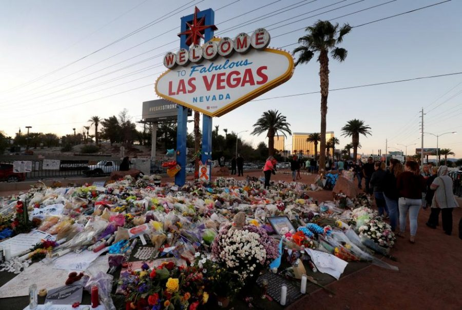 The+%22Welcome+to+Las+Vegas%22+sign+is+surrounded+by+flowers+and+items%2C+left+after+the+October+1+mass+shooting%2C+in+Las+Vegas%2C+Nevada+U.S.+October+9%2C+2017.+REUTERS%2FLas+Vegas+Sun%2FSteve+Marcus