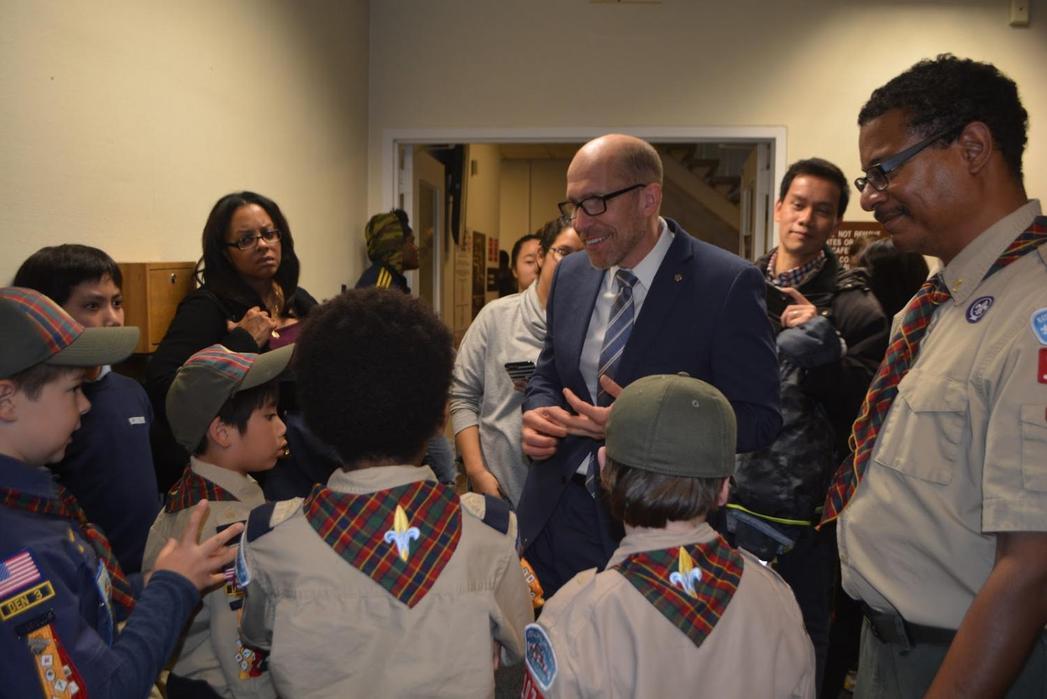 Councilmember Tom Hucker speaks with a group of young boy scouts. Tom Hucker (District 5), is our area's representative on the Montgomery County Council. He represents the communities of Briggs Chaney, Burnt Mills, Burtonsville, Calverton, Cloverly, Colesville, Fairland, Four Corners, Hillandale, Lyttonsville, Silver Spring, Takoma Park, and White Oak.