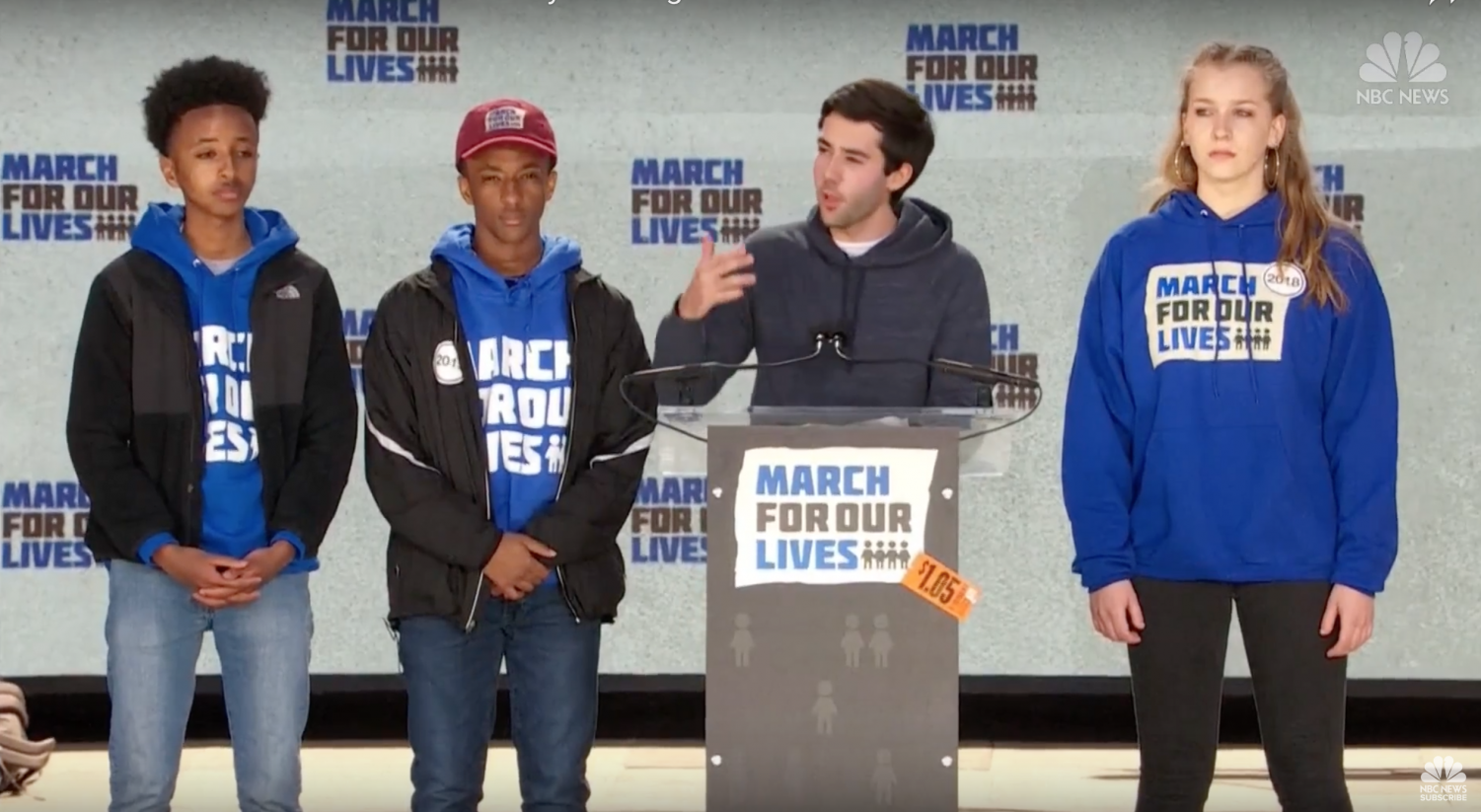 (left to right) Nate Tinbite, Michael Solomon, Matthew Post, and Brenna Levitan, stand on stage at the March For Our Lives.