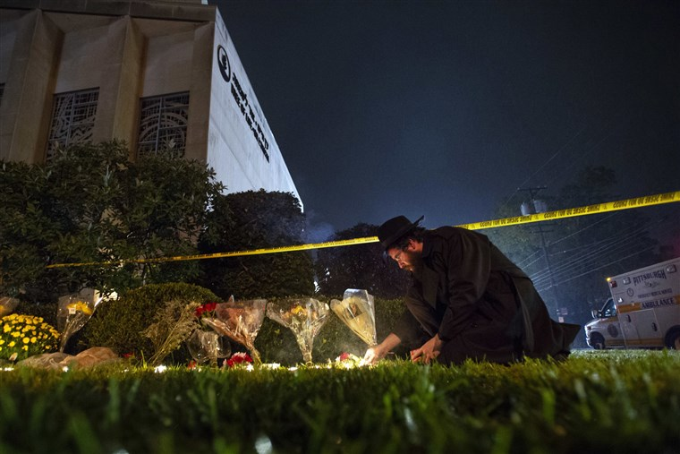 Rabbi Eli Wilansky lights a candle after a mass shooting at Tree of Life Synagogue in Pittsburgh's Squirrel Hill neighborhood on Saturday.