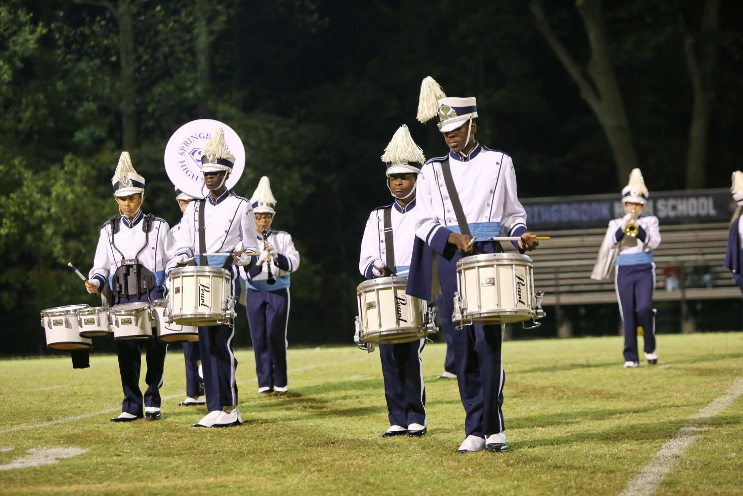 Springbrook's marching band performs at the Homecoming game.