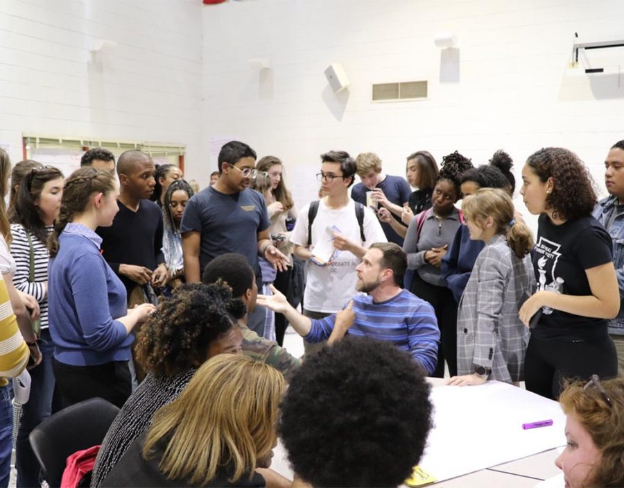 Students and parents debate the merits of the analysis at an April meeting at John F. Kennedy High School.