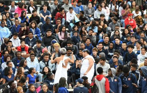 Students watch an October pep rally.