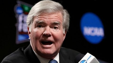 NCAA President Mark Emmert dresses reporters at a 2019 press conference.