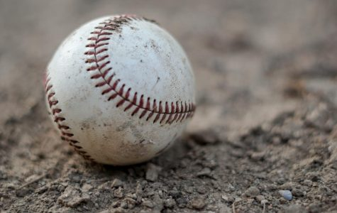 A baseball in the dirt.